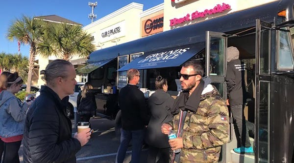 Customers line up at the Grounds of Grace coffee bus, which provides jobs for youth in a troubled North Jacksonville community.