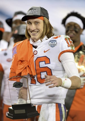 Trevor Lawrence, seen here holding the MVP trophy after beating Notre Dame for the ACC Championship, is going to the No. 1 NFL draft pick for the Jaguars. Like it or not, America will have to accept the fact the Jaguars could be on a path to sustained success.