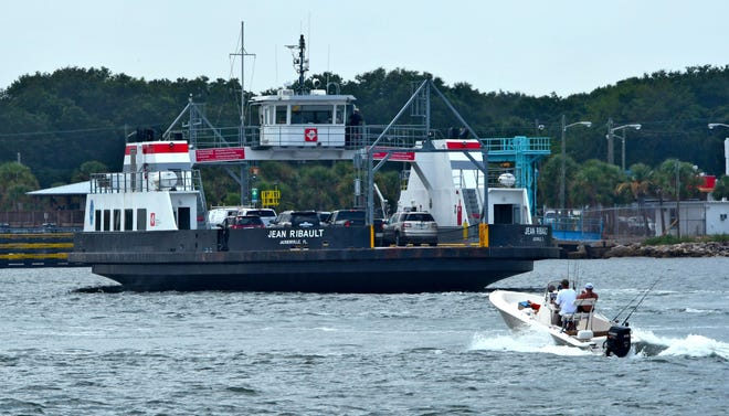 The Jean Ribault, the St. Johns River Ferry's ship, heads to the Ft. George slip in July 2017 as a powerboat heads along the St. Johns River. The ferry will cease operations from Sept. 4 to Oct. 31 for ongoing repairs, the JTA said. [Bob Mack/Florida Times-Union]