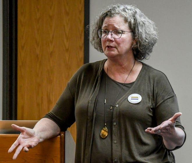 """Jane Holwerda leads a discussion about the suffrage movement Oct. 20 at the Finney County Museum during an Evening at the Museum session. The program was titled """"The 19th Amendment at 100."""" Holwerda is Dodge City Community College's vice president of academic affairs. The museum will be starting its 2021 noon and evening programs in January."""