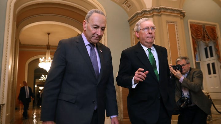 In this 2018 picture (from left) Senate Minority Leader Charles Schumer (D-NY) and Senate Majority Leader Mitch McConnell (R-KY) walk side-by-side to the Senate Chamber at the U.S. Capitol in Washington, DC.