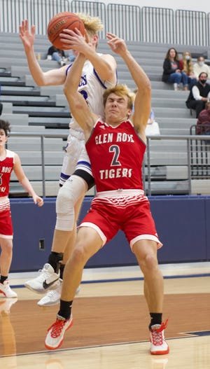 Glen Rose's Austin Worthen gets fouled by a Weatherford defender while grabbing a rebound on Monday in Weatherford.