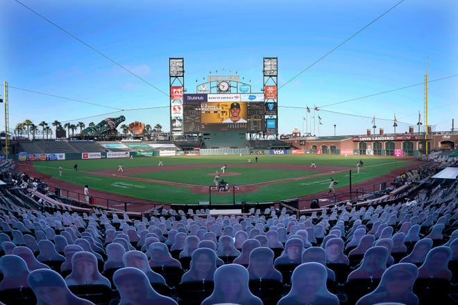 Cardboard cutouts rest in seats at Oracle Park as the San Francisco Giants play the San Diego Padres during the first inning of a baseball game in San Francisco, in this July 29 file photo.