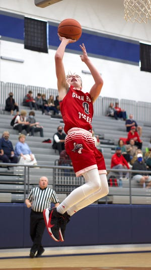 Glen Rose's Matthew Hammonds goes up for two of his game-high 24 points Monday at Weatherford.