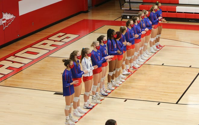 West Henderson's volleyball team lines up during introductions at Tuesday's match at Erwin. It was West's first match back since quarantine.