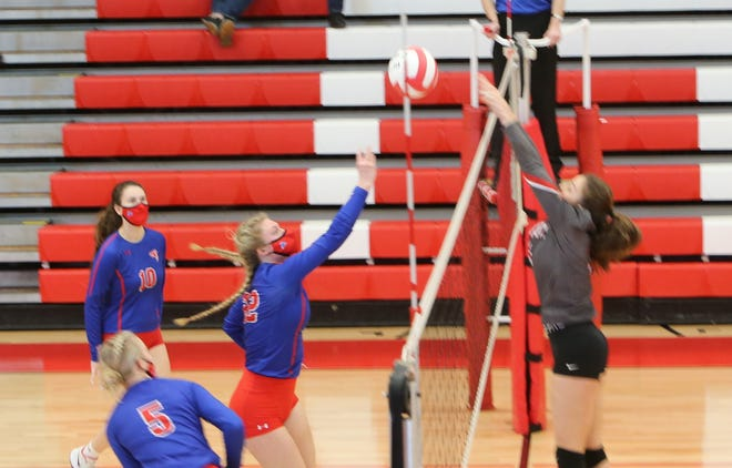 West Henderson's Kera Putnam returns a shot during Tuesday's match at Erwin.
