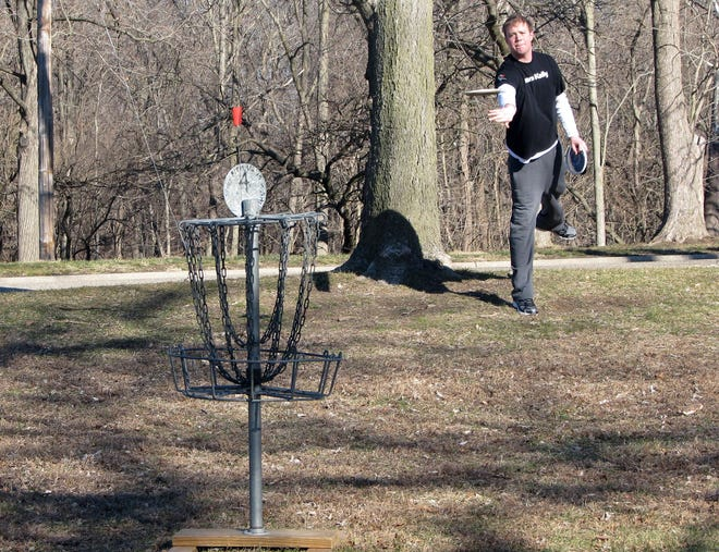 In this 2012 file photo, a disc golfer tosses at a basket at Bradley Park during the 9th annual Peoria Frisbee Club Ice Bowl.