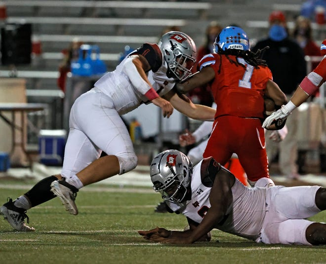 Lubbock-Cooper defensive end Kyler Jordan (1) tackles Monterey quarterback Ky'Shon Harris (7) during a non-district game on Oct. 15, 2020 at PlainsCapital Park at Lowrey Field. [Brad Tollefson/For A-J Media]