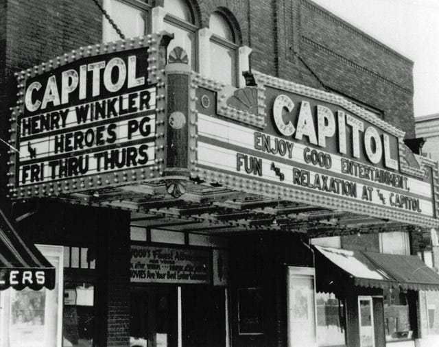 The Capitol Theater opened New Year's Eve 1925 and was destroyed by fire in 1984. It stood on the corner of South Main and West Miller streets in Newark. It is a parking lot now.