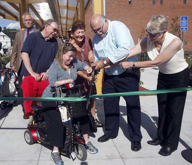 Karen Foran Dempsey assists with the cutting of the ribbon for the new handicap-accessible entrance to the Framingham Public Library in 2014. With her are, from left, are library trustee Sam Klaidman; Framingham Town Moderator Teri Banerjee; and Selectmen Charlie Sisitsky and Cheryl Tully Stoll.