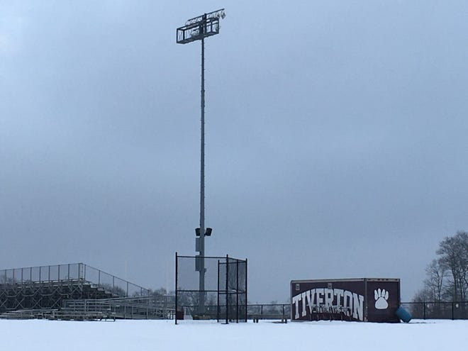 The Town Council decided to not replace the light at Tiverton High School due to budget concerns.