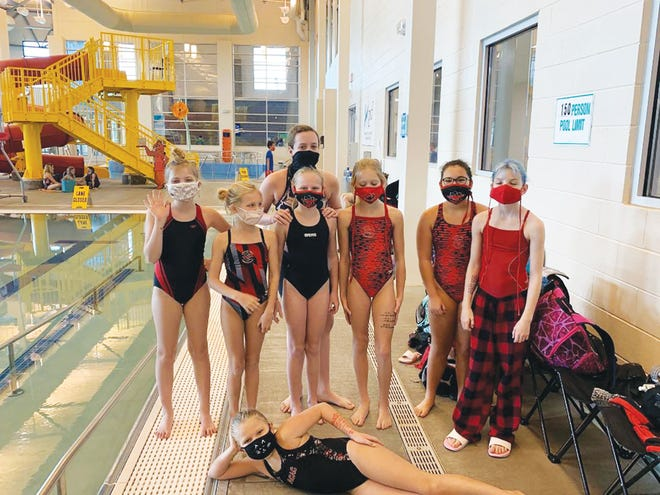 Atomic City Aquatic Club swimmers get ready to remove their masks and compete in the 2020 Kingsport Piranhas Holiday Challenge in Kingsport.