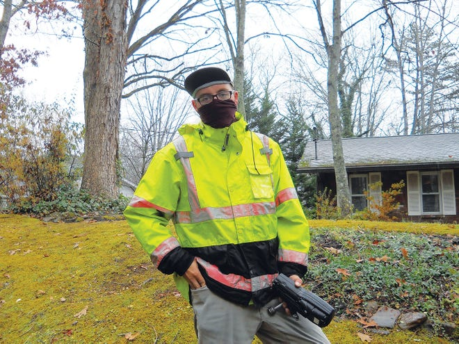 Cody Glandon with the company Olameter, which the city of Oak Ridge contracts with, checks a water meter at an Oak Ridge resident's home.