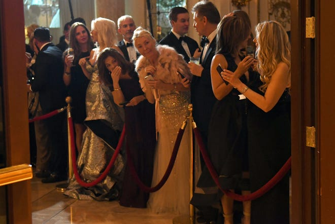 Guests arrive at Mar-a-Lago in 2019 to celebrate the new year with President Trump.