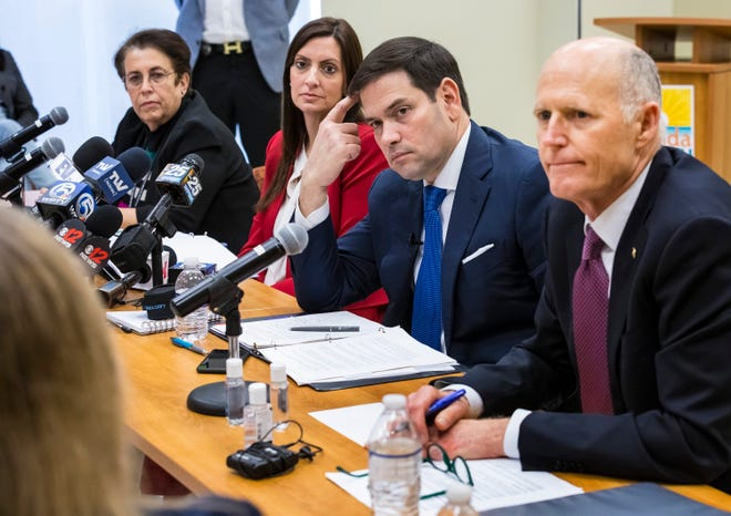 Dr. Alina Alonso, director of the Florida Department of Health in Palm Beach County, left, Florida Lt. Gov. Jeanette Nunez and Florida's U.S. Sens. Marco Rubio and Rick Scott listen during a press event about the coronavirus in West Palm Beach on March 6, 2020.