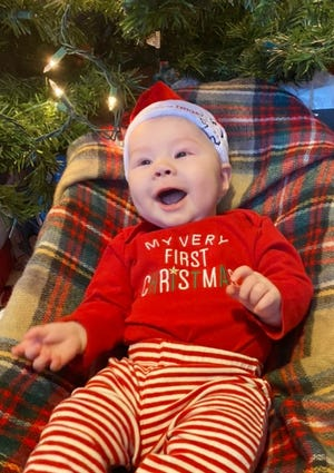Benjamin Cam Shields, 4 months, shows off his enthusiasm for celebrating his first Christmas and New Year's holiday season. Benjamin is the son of Isaac and Sarah Shields.