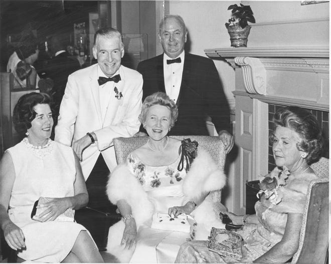 Margaret Smith, center, one of the early supporters of Strawbery Banke Museum, chats with Mrs. John Kelleher, Jr., left, husband James Barker Smith (in white tux), Edward P. Gilgun, and Mrs. Richard J. Sutherland, right, in a 1965 fundraising ball at Wentworth by the Sea Hotel in New Castle.