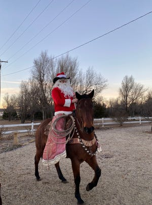 Mike Greenleaf of Medicine River Rodeo Company recently visited Haviland Grade School and played the role of Santa Claus.