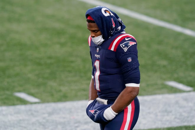 New England Patriots quarterback Cam Newton stands on the sideline during the second half of Monday night's game against the Buffalo Bills in Foxboro.