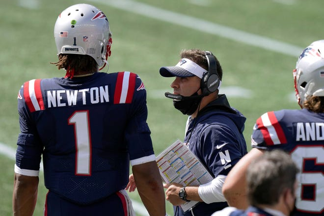 Patriots offensive coordinator Josh McDaniels talks with quarterback Cam Newton during a game earlier this season. Could Sunday's game against the Jets be the last for McDaniels with the Patriots?