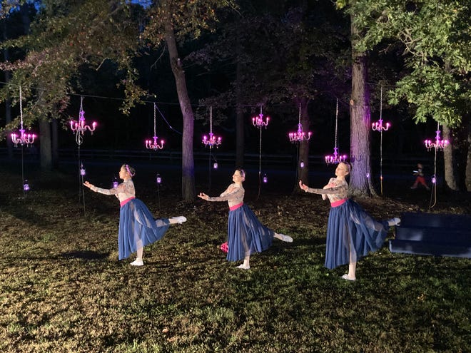 With chandeliers providing an elegant ambience, dancers from the State Ballet of Rhode Island perform during a drive-through ballet at Slater Park in Pawtucket.