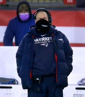 Patriots coach Bill Belichick watches his time from the New England sideline in the second half.  [The Providence Journal / Kris Craig]