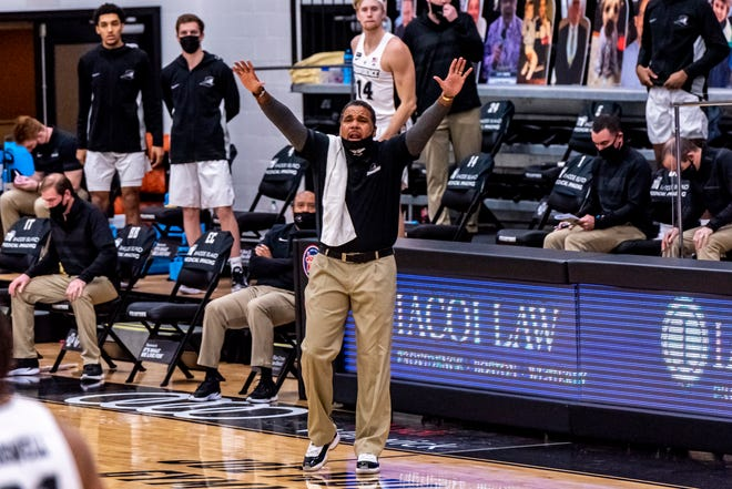 Friars coach Ed Cooley shouts instructions during Sunday's game against DePaul at Alumni Hall. PC hosts Butler on Wednesday.