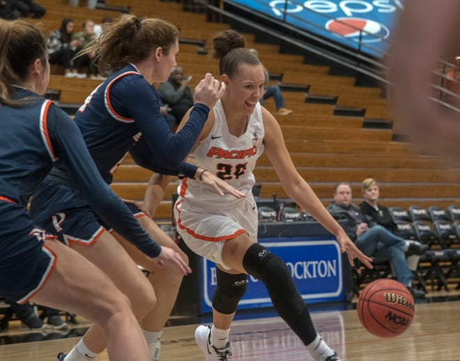 Pacific's Valerie Higgins, right, drives on Pepperdine's Hannah Friend during a West Coast Conference women's basketball game Jan. 4 at the Spanos Center in Stockton.