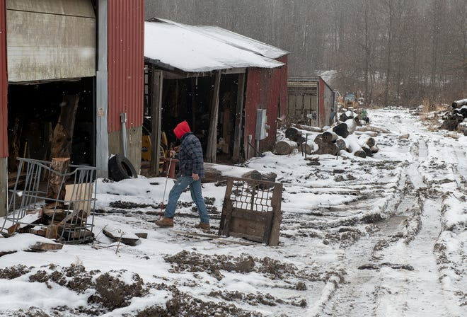 Redgate Sawmill Owner Roy Harris walks into the barn where the work on the wood is done.