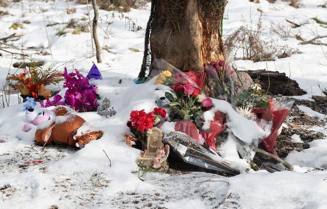 A roadside memorial is located at the crash site on Peck road where Marlana J. Mullin, 22, and Christine Shead, 12 and Evey Montecalvo, 13, died following the crash of a pick-up truck driven by Julianne M. Shead, 41, of Ravenna. Shead was charged with aggravated vehicular homicide. The memorial includes a wreath, crosses, snow covered stuffed animals and flowers.