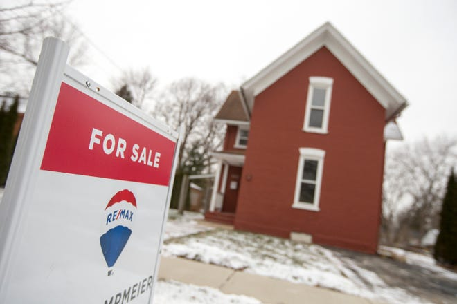 The housing market is doing well and has exceeded expectations despite pandemic conditions this year. A residence is posted for sale on North Prospect Street on Tuesday, Dec. 29, 2020, in Rockford.