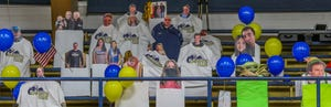 Cutouts stand on the benches during the Ell-Saline basketball game at Sacred Heart High School in December. Spectators were not allowed to attend the games due to COVID-19 regulations.