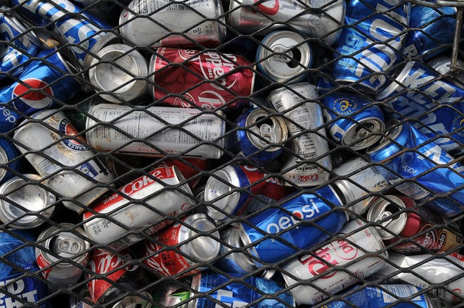 Empty aluminum cans that were donated to the Kansas Honor Flight filled two trailers after the cans were collected from dropoff locations across central Kansas. The two trailers were brought to Salina Iron and Metal Company, 312 N. 5th St., with each trailer weighing over 1,600 pounds.