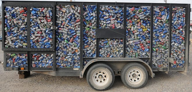 Empty aluminum cans that were donated to the Kansas Honor Flight fill a trailer that was parked at one of the dropoff locations in Salina at the corner of Ninth and Pine streets.