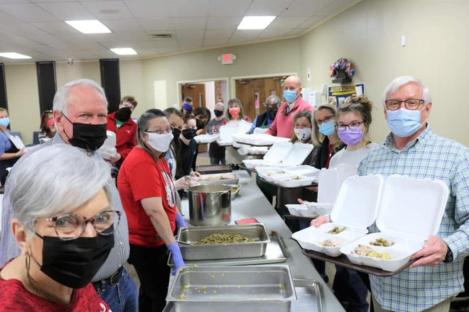First Baptist Church of Stephenville volunteers serve meals as the church hosted its Christmas Dinner for the community from 11 a.m. to 1 p.m. on Christmas Day.