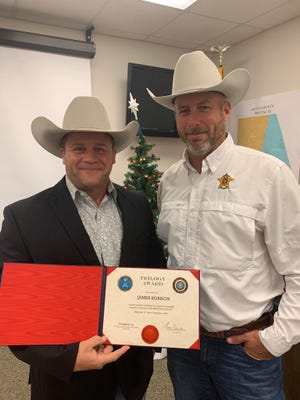 Erath County Sheriff's Lt. James Robison recently completed the FBI-Leeda executive leadership training program. This program is a training program for members in executive positions of law enforcement agencies. It is designed to gain contacts with other professionals in the field, while sharpening skills and instilling the qualities needed to successfully lead in the field of Law Enforcement. Robison, left, is pictured with Erath County Sheriff Matt Coates.