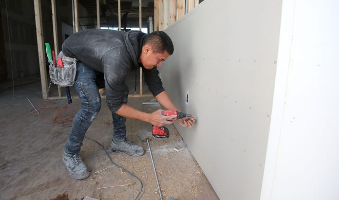 George Martinez works on construction inside the new location of The Hospice Cleveland County Foundation located on South Washington Street in Shelby.