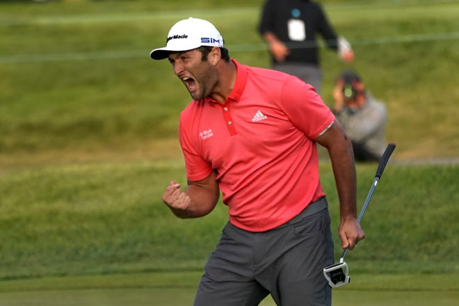 Jon Rahm celebrates his winning putt in sudden death last year at the BMW Championship at Olympia Fields near Chicago. He defeated Dustin Johnson.