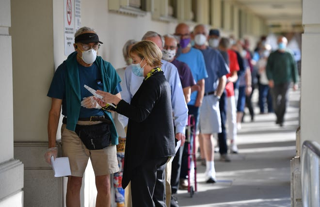 People with appointments to get the COVID-19 vaccination line up Tuesday at the William L. Little Health and Human Services building at 2200 Ringling Blvd. in Sarasota.