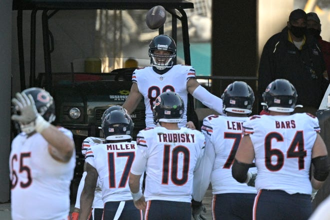 Bears tight end Jimmy Graham (80) celebrates in the tunnel after catching a touchdown pass against the Jacksonville Jaguars on Sunday. [Phelan M. Ebenhack/The Associated Press]