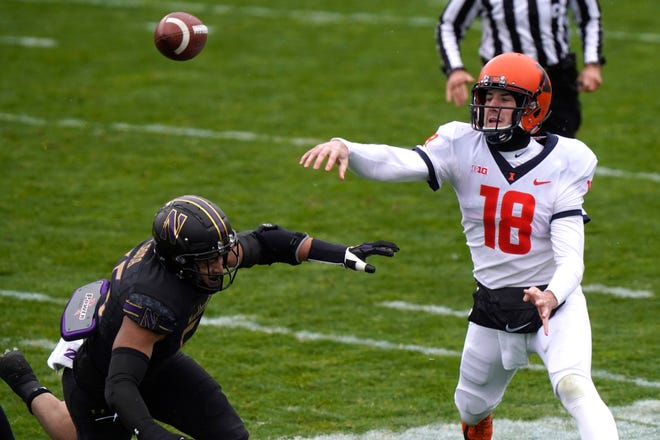 Brandon Peters will return for a third season as the Illinois quarterback and sixth in college football. [Nam Y. Huh/The Associated Press]