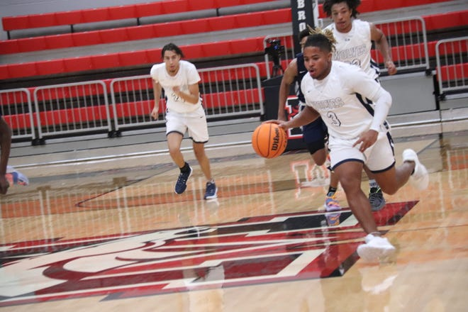 Shawnee junior guard Jaylon Orange (3) dribbles the ball on the break against Southmoore on Monday in the first round of the Cornerstone Bank Mustang Holiday Classic Monday at Mustang High School.