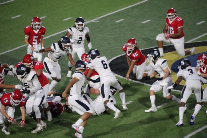 Shawnee's Hudson Davis-Barkus (6) wraps up the Durant ball carrier as teammate Joe Maytubby (1) pursues on the play during the 2020 season. Davis-Barkus was named District 5A-3 Outside Linebacker of the Year and Maytubby was selected as 5A-3 Defensive Lineman of the Year.