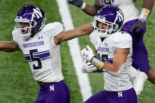 Northwestern defensive back Brandon Joseph, right, celebrates with teammate JR Pace (5) after intercepting a pass in the end zone during the first half of the Big Ten championship NCAA college football game against Ohio State, Saturday, Dec. 19, 2020, in Indianapolis.