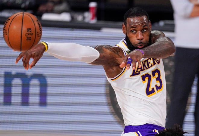 Los Angeles Lakers' LeBron James (23) passes the ball in Game 3 of basketball's NBA Finals on Oct. 4 in Lake Buena Vista, Fla.