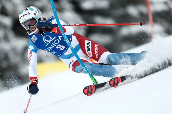 Switzerland's Michelle Gisin speeds down the course during an alpine ski, women's World Cup slalom, in Semmering, Austria, Tuesday.