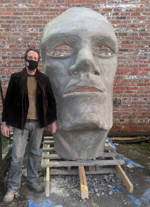 Craven Arts Council & Gallery's new executive Director Jonathan Burger built a seven-foot cement face called HOPE. It is an underwater sculpture that will look upwards toward the light filtering down through the water off Santa Rosa Beach, Fla.