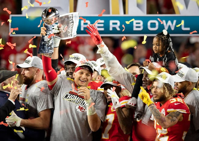 No. 1: Kansas City Chiefs quarterback Patrick Mahomes celebrates with the Vince Lombardi Trophy after his team's Super Bowl LIV win over the San Francisco 49ers on Feb. 2 at Hard Rock Stadium in Miami Gardens, Fla. Mahomes was named Super Bowl MVP.