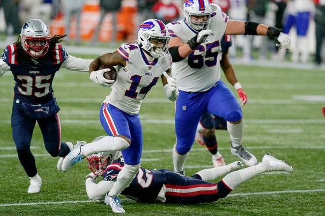 Buffalo's Stefon Diggs runs from New England's Kyle Dugger on his way to a touchdown in the second half of Monday's game.