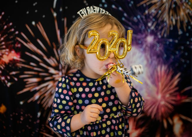 Frances Duffy, 3, of Worcester, celebrates 2020 during the Noon Year's Eve party, Dec. 31, 2019, at the EcoTarium.